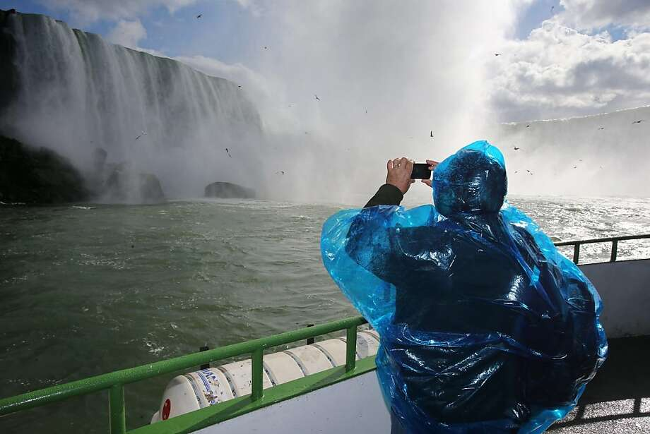 See any barrels go over? A passenger takes a photo of Niagara Falls from the upper deck of the Maid of the Mist on the penultimate day of Canadian operations 