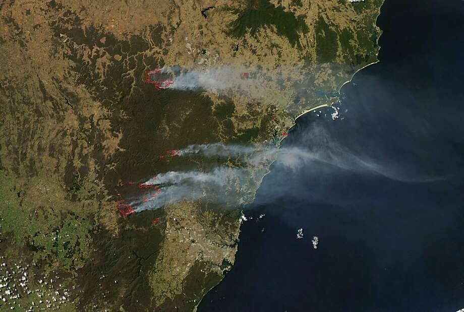 Australia on fire: A NASA satellite image shows smoke rising from several wildfires burning near Sydney. Thousands of largely 