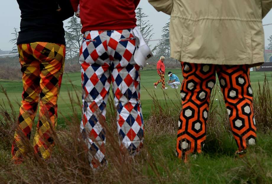 Often mistaken for clowns, fans of John Daly (orange shirt) follow his exploits on the 7th hole of BMW Shanghai Masters at Lake Malaren Golf Club in Shanghai. Photo: Mark Ralston, AFP/Getty Images