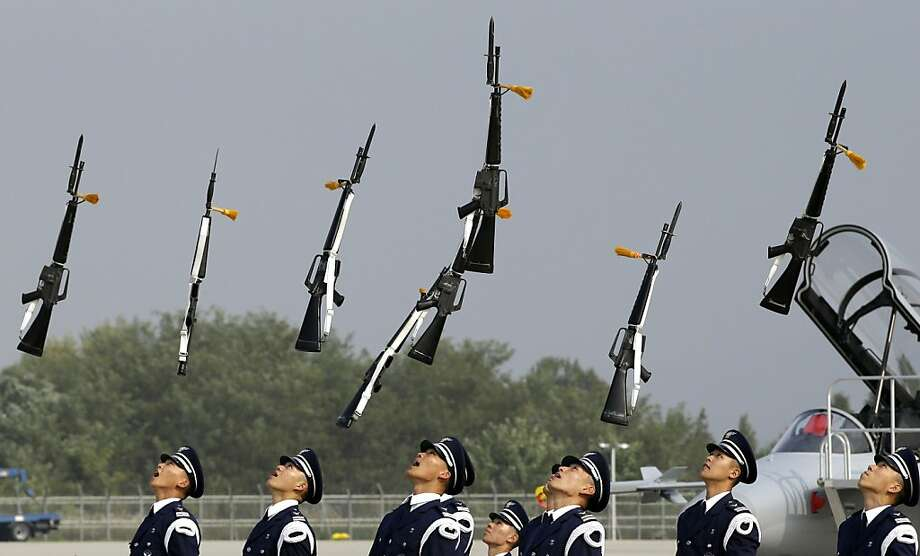 Available for halftime shows: Air force honor guards toss their rifles like cheerleader batons during a performance at the Seoul International Aerospace and Defense Exhibition in Cheongju, South Korea. Photo: Lee Jin-man, Associated Press
