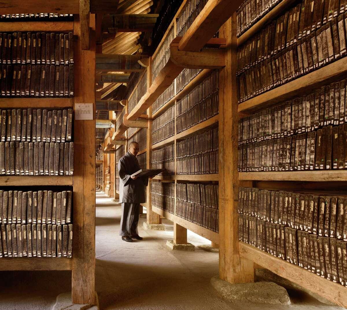 The Tripitaka Koreana, 1251, Haeinsa Temple, South Korea. This view shows the inside of the longer of the two halls that house the Tripitaka Koreana.From