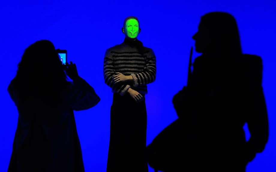 "No, not creepy at all:A video-animated mannequin greets visitors to French fashion designer Jean Paul Gaultier's ""From Sidewalk to Catwalk"" exhibition at the Brooklyn Museum. The mannequin wears an outfit created by Gaultier. Photo: Emmanuel Dunand, AFP/Getty Images"