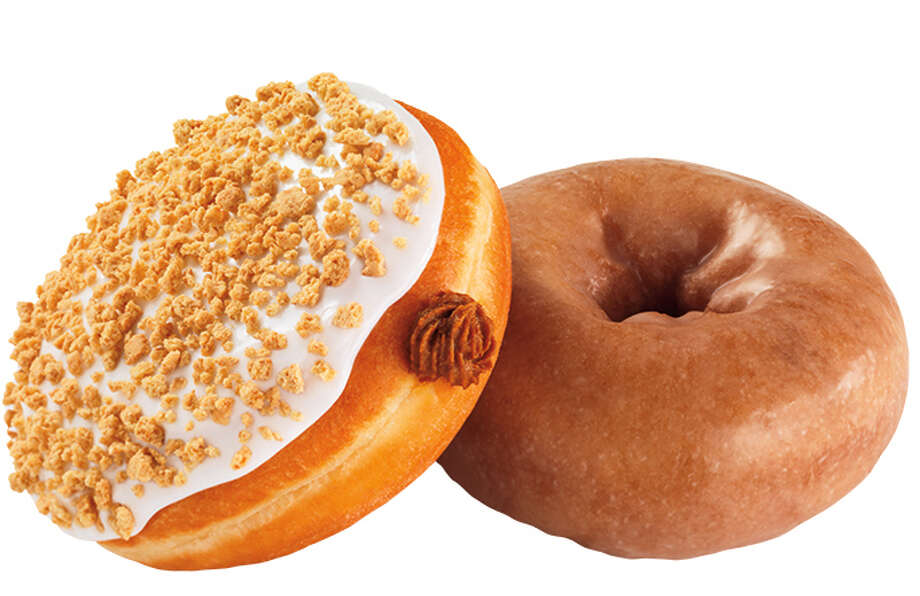 Houston-area Dunkin' Donuts is offering pumpkin donuts and Munchkins (donut holes).  On the left, the pumpkin pie donut is a filled with pumpkin-pie flavored buttercreme and topped with icing and graham cracker sprinkles. On the right, a glazed pumpkin cake donut. Photo: Jim Scherer, © Jim Scherer 2013 / © Jim Scherer 2013