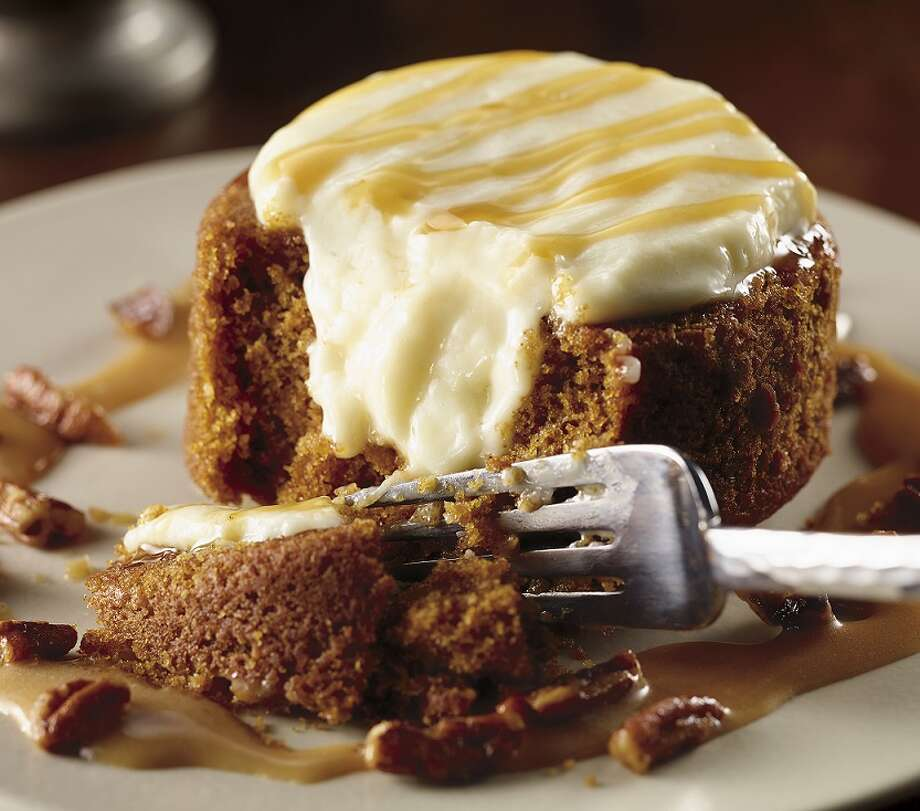 Pumpkin Spice Lava Cake is served with cream cheese icing and a caramel bourbon drizzle at LongHorn Steakhouse. Photo: Dick Patrick, © 2013 Dick Patrick Studios / © 2013 Dick Patrick Studios
