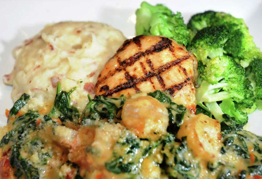 Dave and Buster's. Crossgates Mall, Guilderland.Chicken and Shrimp Rockefeller with mashed potatoes and steamed broccoli at Dave and Buster's restaurant on Friday, Oct. 18, 2013, at Crossgates Mall in Guilderland, N.Y. (Cindy Schultz / Times Union) Photo: Cindy Schultz / 00024289A