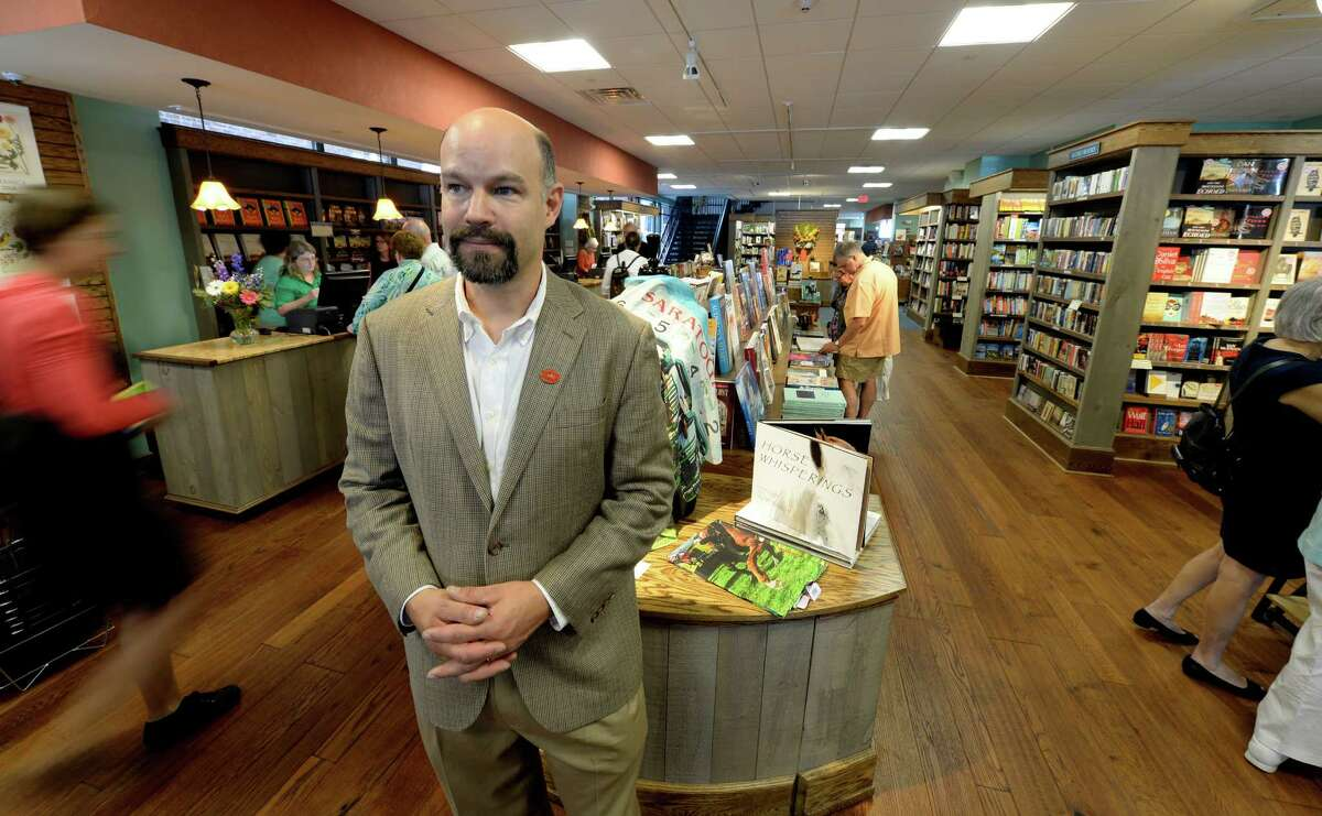Owner Chris Morrow watches as patrons come in the door at the Northshire Bookstore Aug. 5, 2013 on opening day in Saratoga Springs, N.Y. (Skip Dickstein/Times Union)
