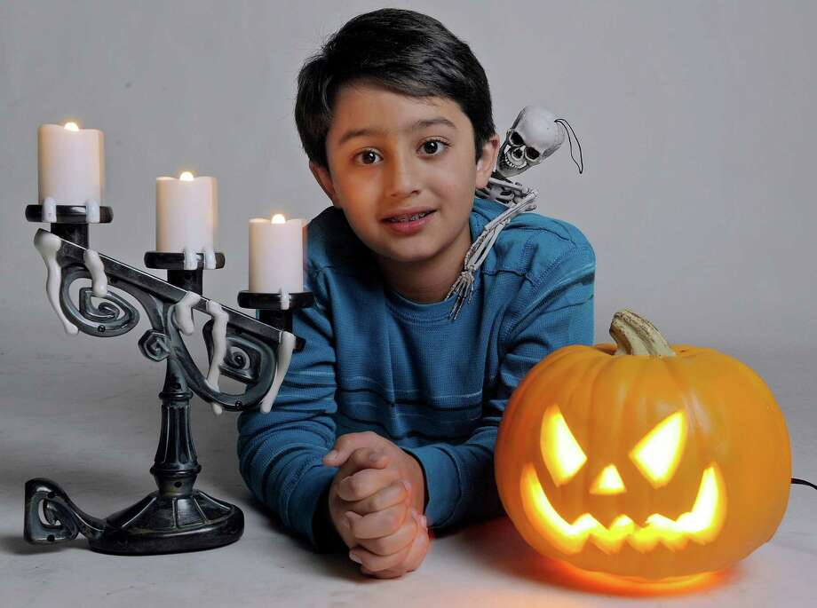 Aman Singh, 9, photographed at the Times Union on  Tuesday, Oct. 22, 2013 in Colonie, NY.  Singh is the grand prize winner in the Times Union Halloween storytelling contest.  (Paul Buckowski / Times Union) Photo: Paul Buckowski / 00024331A