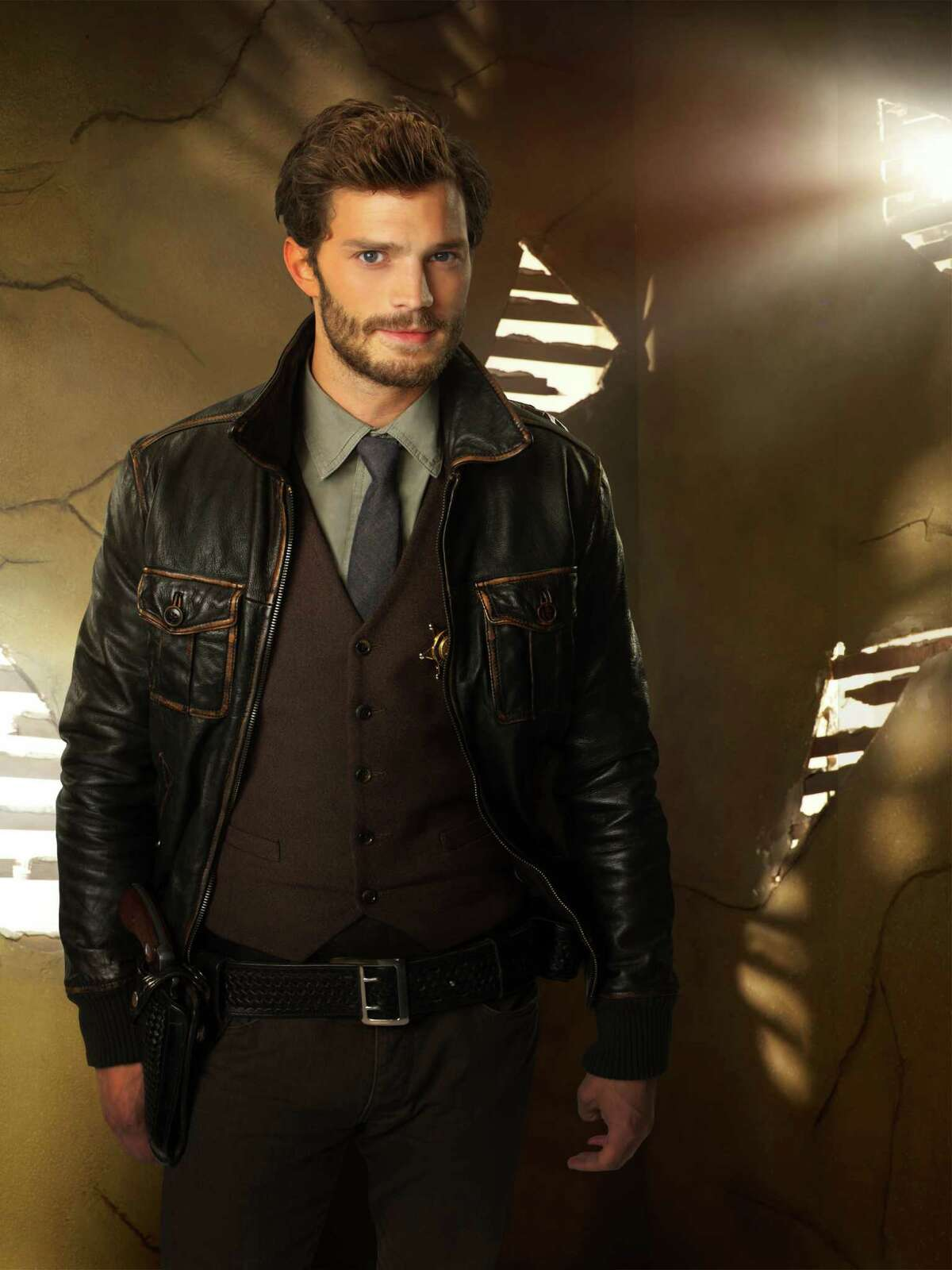 """In this photo released by ABC, Jamie Dornan guest stars as Sheriff Graham on ABC's """"Once Upon a Time."""" ?""""Fifty Shades of Grey?"""" has its male lead, again. Dornan has been cast as Christian Grey, the lead role that Charlie Hunnam withdrew from recently. (AP Photo/ABC, Craig Sjodin/Kharen Hill) ORG XMIT: CAET225"""