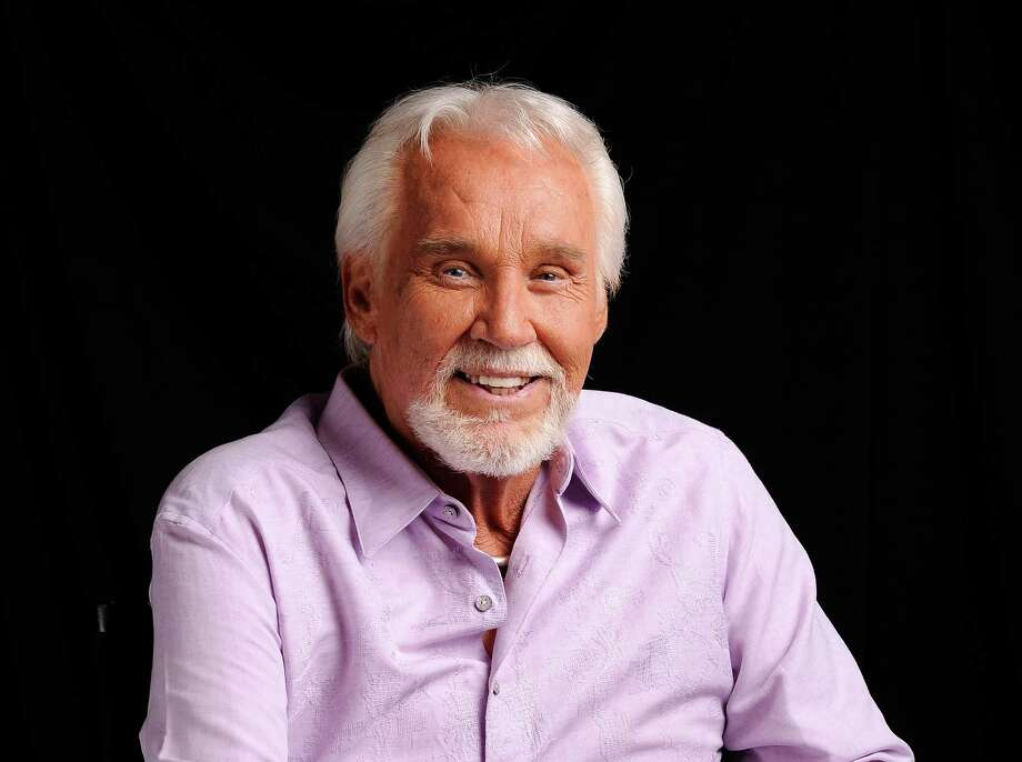 "FILE - In this Sept. 4, 2013 file photo, Kenny Rogers poses for a portrait at The Hot Seat in Nashville, Tenn. Rogers long ago cemented his legacy in the world of popular music, and we'll get another reminder of this on Sunday, Oct. 27, 2013, when he's finally inducted into the Country Music Hall of Fame with Bobby Bare and the late ""Cowboy"" Jack Clement. Many believe Rogers' induction is years late since few did as much to spread country music beyond its once rural borders. (Photo by Donn Jones/Invision/AP, File) ORG XMIT: CAET270 Photo: Donn Jones / Invision"