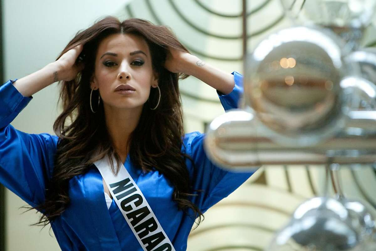 Nastassja Bolivar, Miss Nicaragua 2013, waits to be photographed at the Crowne Plaza Moscow World Trade Centre, on Thursday, Oct. 24, 2013, in Moscow. They will compete for the title of Miss Universe Saturday Nov. 9, 2013, in Moscow.