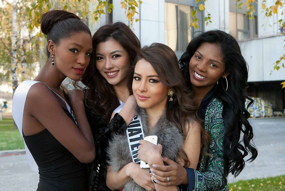 Titi Ayenew, Miss Israel 2013; Carey Ng, Miss Malaysia 2013;  Samayoa, Miss Guatemala 2013; and Vaumara Rebelo, Miss Angola 2013; wait outside the Crowne Plaza Moscow World Trade Centre, on Wednesday Oct. 23, 2013, in Moscow. They will compete for the title of Miss Universe Saturday Nov. 9, 2013, in Moscow. Photo: Richard Salyer, Associated Press