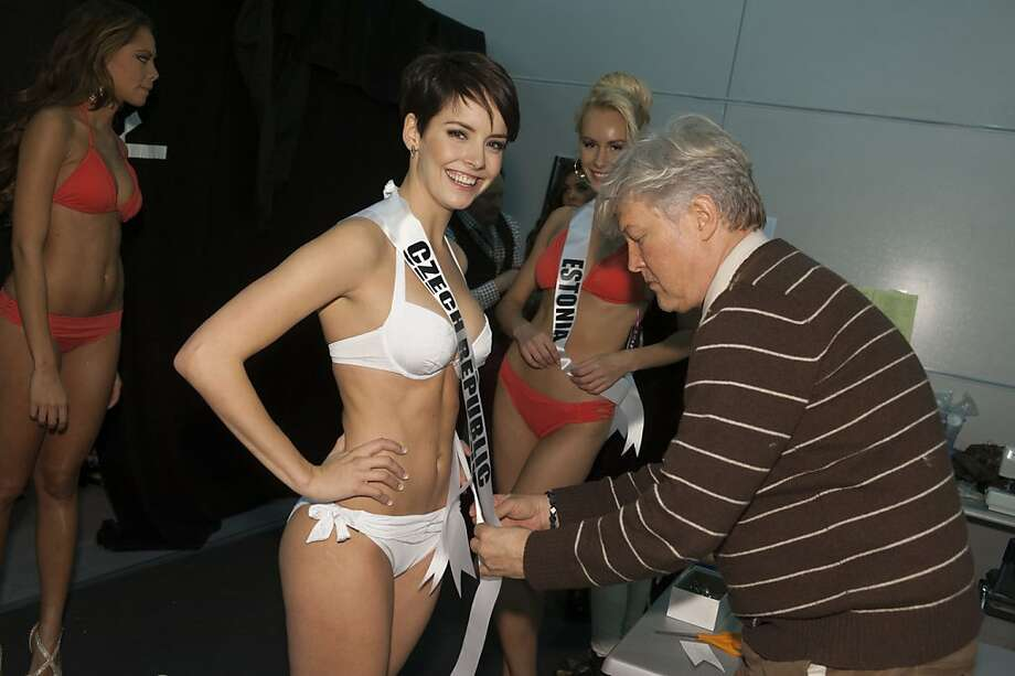 Gabriela Kratochvílová, Miss Czech Republic 2013, is fitted by Costume Designer David Profeta, right, during registration and fittings Wednesday Oct. 23, 2013, in Moscow. Kratochvílová will compete for the Miss Universe title in Moscow, Saturday, Nov. 9, 2013. Photo: Patrick Prather, Associated Press