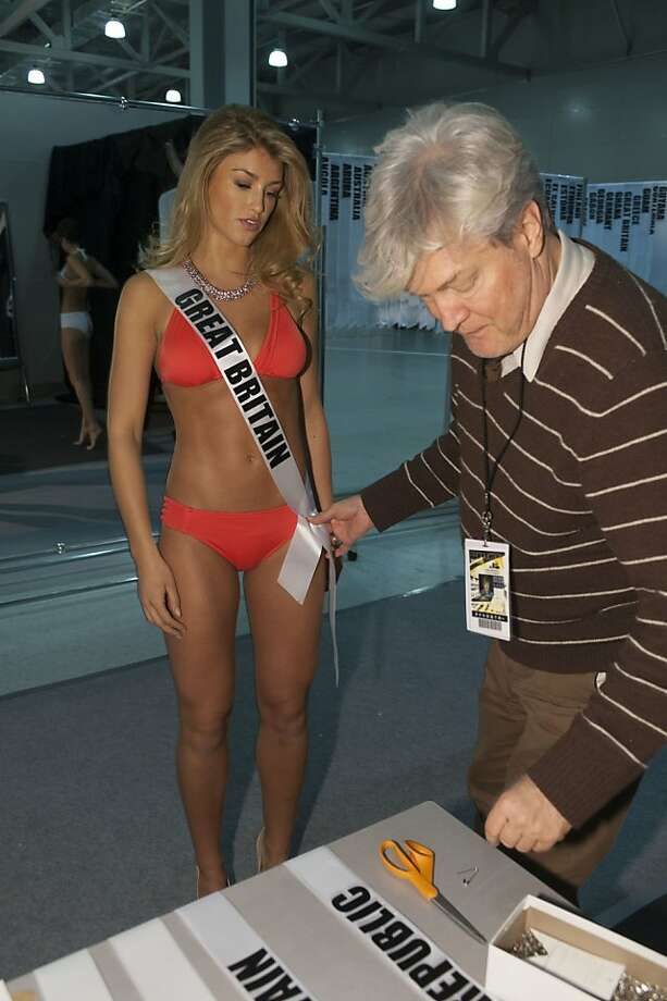 Amy Willerton, Miss Great Britain 2013, is fitted by Costume Designer David Profeta, right,  during registration and fittings on Wednesday, Oct. 23, 2013 in Moscow. Willerton will compete for the Miss Universe title in Moscow, Saturday, Nov. 9, 2013. Photo: Patrick Prather, Associated Press