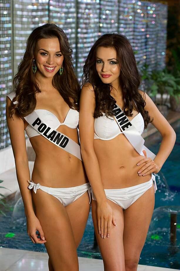 Paulina Krupinska, left, Miss Poland 2013, and Olga Storozhenko, Miss Ukraine 2013, pose in their swimwear at the Crowne Plaza Moscow World Trade Centre, on Wednesday, Oct. 23, 2013, in Moscow. They will compete for the Miss Universe title in Moscow, Saturday, Nov.  9, 2013. Photo: Darren Decker, Associated Press