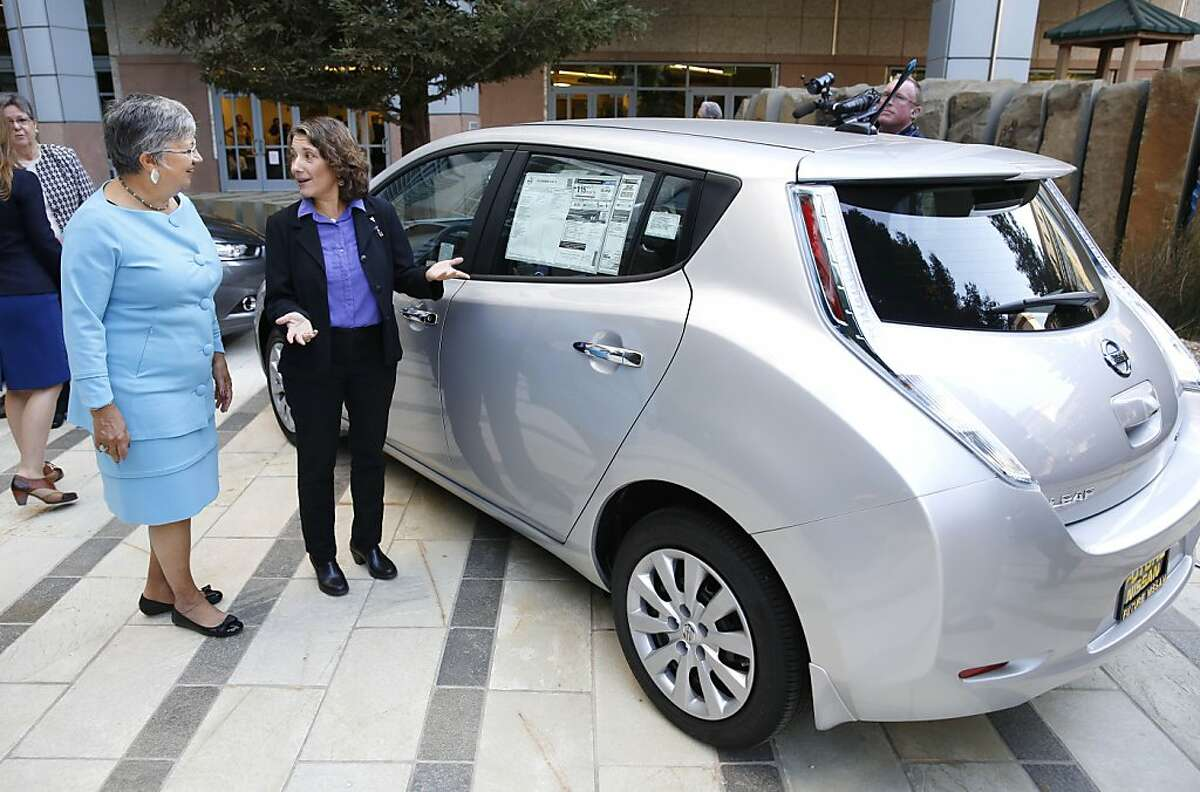 Mary Nichols, chairwoman of the California Air Resources Board, left, and Deb Markowitz, secretary of the Vermont Agency of Natural Resources view an electric car displayed in Sacramento, Calif., following a news conference to announce the signing of an agreement on zero emissions cars, Thursday, Oct. 24, 2013. Nichols, Markowski and the representatives of six other states signed an memorandum of understanding to work together to create charging stations and other fueling infrastructure needed to get 3.3 million zero-emission vehicles on those states roadways by 20225 to curb greenhouse gas pollution.(AP Photo/Rich Pedroncelli)