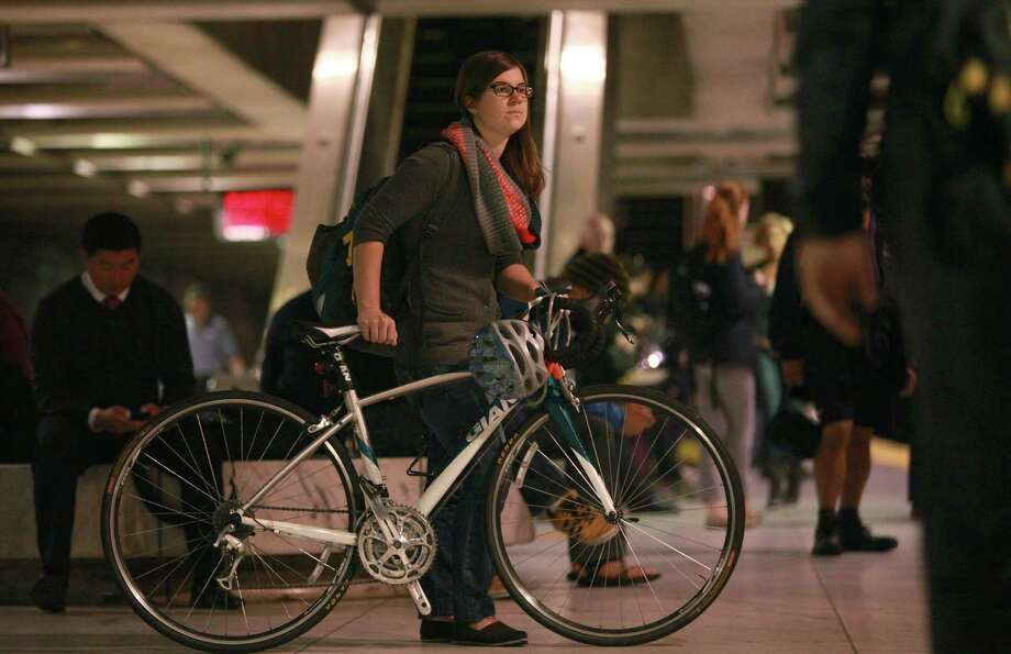 Berkeley student Sara Knox heads to school from Embarcadero Station in San Francisco with her bike. Photo: Liz Hafalia / The Chronicle / ONLINE_YES
