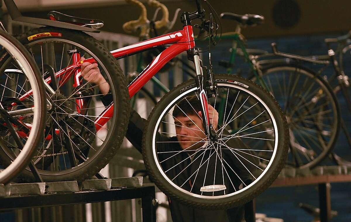 Matthew Sobin locks his bike at the 19th Street Oakland bart station in Oakland, California, on Thursday, October 24, 2013.