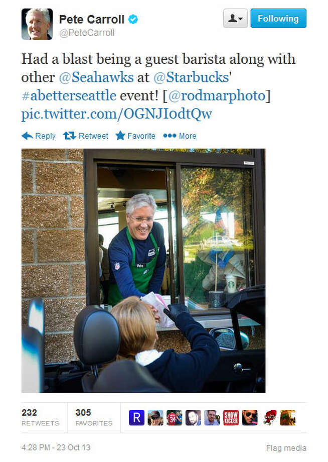 Seahawks head coach Pete Carroll serves a coffee to a drive-through customer at a Seattle-area Starbucks on Wednesday. Photo: Screenshot, Twitter
