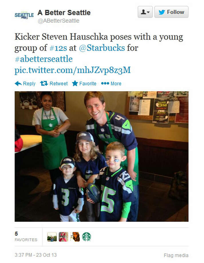 Seahawks kicker Steven Hauschka poses with three young fans at a Seattle-area Starbucks on Wednesday. Photo: Screenshot, Twitter
