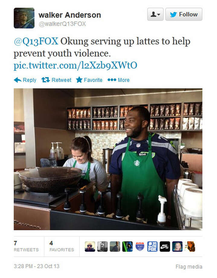 Seahawks tackle Russell Okung works behind the counter at a Seattle-area Starbucks on Wednesday. Photo: Screenshot, Twitter