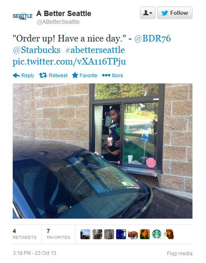Okung serves coffee to a drive-through customer at a Seattle-area Starbucks on Wednesday. Photo: Screenshot, Twitter