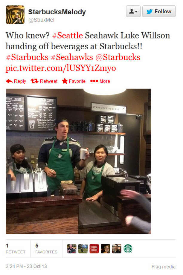 Seahawks tight end Luke Willson towers over his fellow baristas at a Seattle-area Starbucks on Wednesday. Photo: Screenshot, Twitter