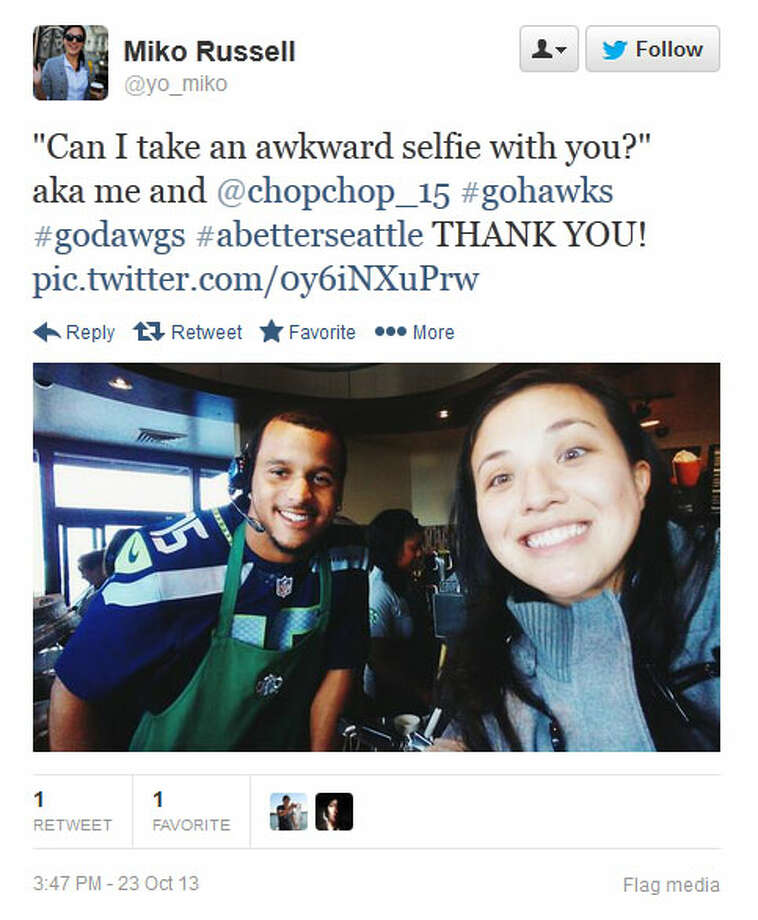 "Kearse poses for an ""awkward selfie"" with a Seahawks fan Wednesday at a Seattle-area Starbucks. Photo: Screenshot, Twitter"