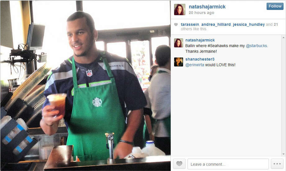 Kearse hands his latest creation to a fan at a Seattle-area Starbucks on Wednesday. Photo: Screenshot, Instagram