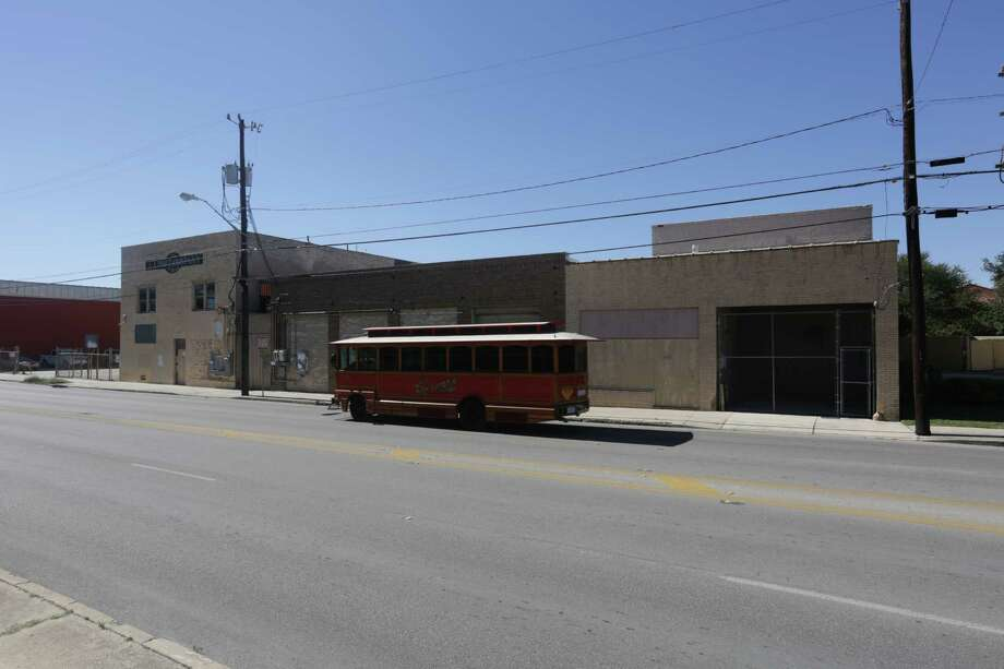 A VIA trolley passes in front of buildings in the 500 block of S. Flores, property which is owned by HEB, whose corporate  headquarters are directly across the street. Photo: BOB OWEN, San Antonio Express-News / © 2012 San Antonio Express-News
