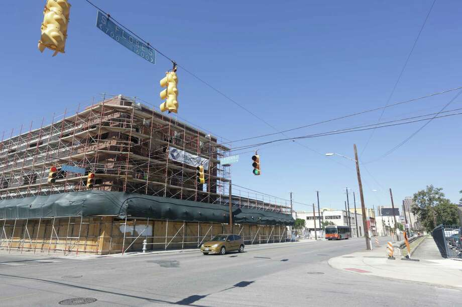 Building under construction at the corner of S. Flores and El Paso will be the HEB Culinary School. Photo: BOB OWEN, San Antonio Express-News / © 2012 San Antonio Express-News