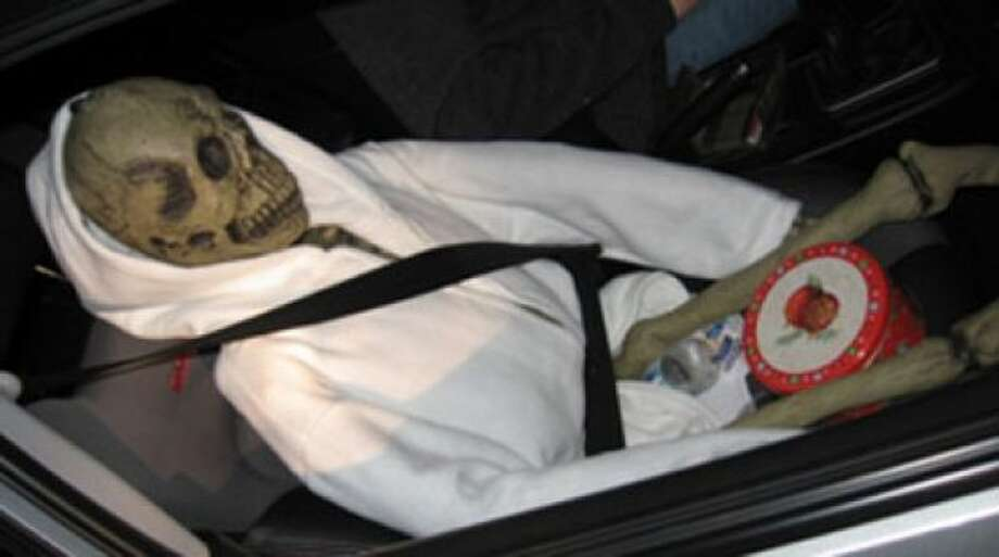 This hoodied, seat-belted skeleton gets the award for most creative dummy. The carpool driver was stopped for speeding and unsafe lane changing on I-5 in 2012, when the trooper noticed the skeleton. It appeared to have a cookie tin between its thighs. Photo: Washington State Patrol