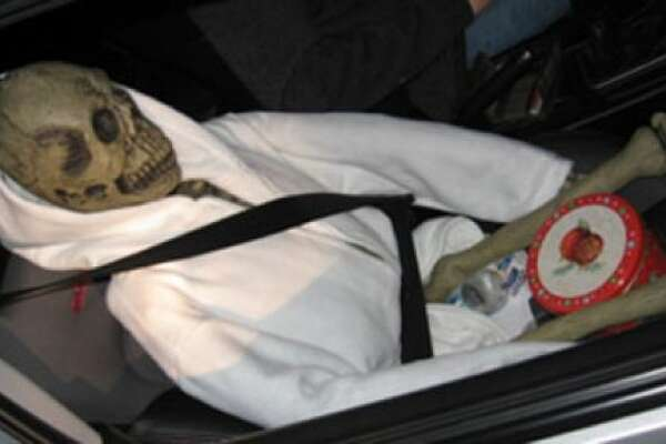 This hoodied, seat-belted skeleton gets the award for most creative dummy. The carpool driver was stopped for speeding and unsafe lane changing on I-5 in 2012, when the trooper noticed the skeleton. It appeared to have a cookie tin between its thighs.