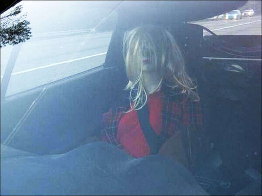 This dummy was riding shotgun on I-5 in Everett on Oct. 24, 2013, when her bad wig gave her away. 