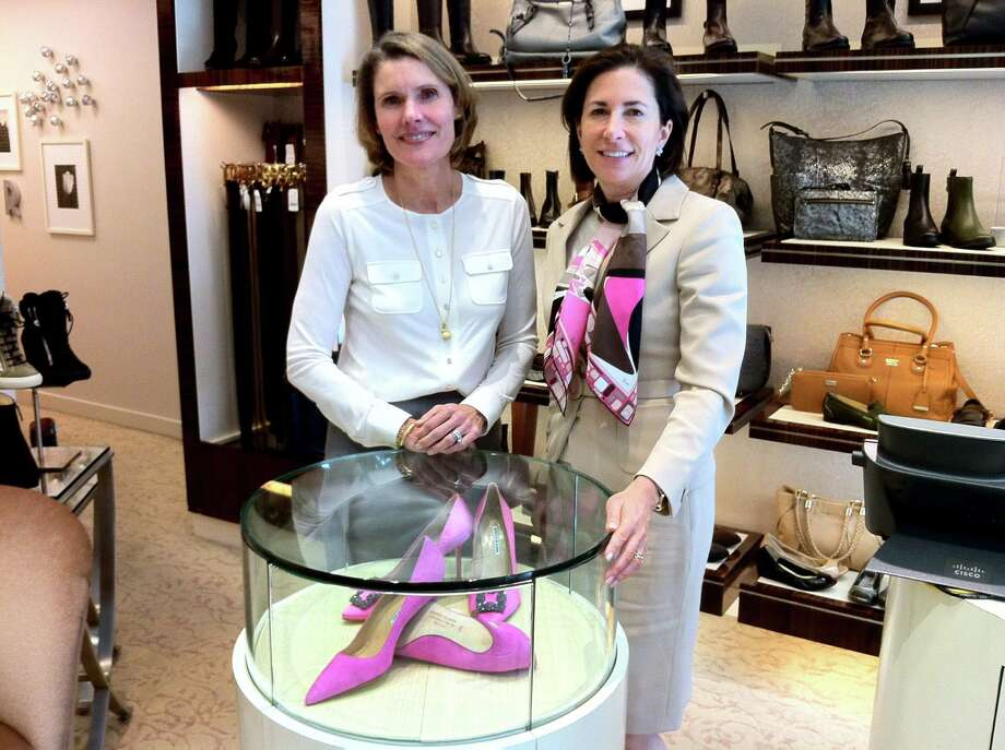 Julie Johnson and Loren Taufield, co-chairwomen of Greenwich, Conn.-based Breast Cancer AllianceâÄôs 18th annual luncheon and fashion show, stand near the display of custom-made Manolo Blahnik pink heels, one of two styles that can be purchased at Richards of Greenwich. Twenty percent of the sales will benefit the alliance, which will be hosting the luncheon at the Hyatt Regency Greenwich on Thursday, Nov. 7, 2013. Photo: Christina Hennessy, Christina  Hennessy / Stamford Advocate