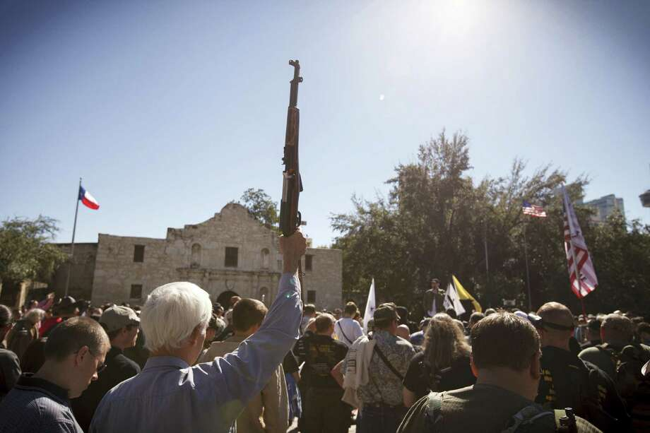 Gun-rights advocates converged on the Alamo on Saturday.   But  are mass shootings the price for gun rights? Photo: Michael Stravato / New York Times