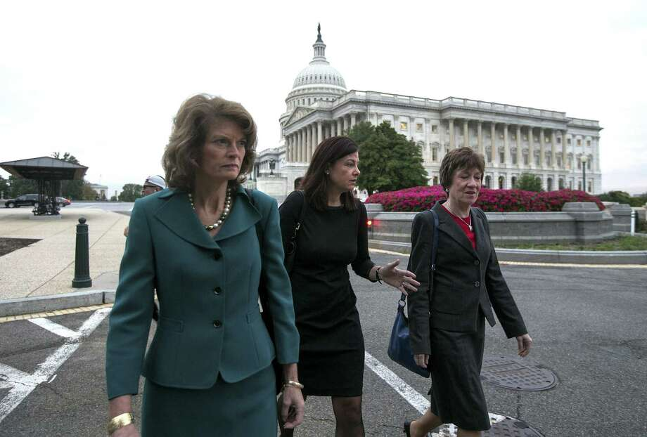 Sens. Lisa Murkowski, R-Alaska, Kelly Ayotte, R-N.H., and Susan Collins, R-Maine, walk to their offices after appearing on morning television shows to discuss the recent government shutdown.   Photo: Doug Mills, New York Times