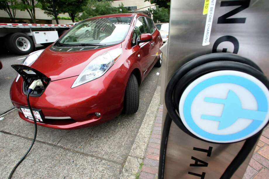 File-This Aug. 18, 2011 file photo shows a Nissan Leaf charges at an electric vehicle charging station in Portland, Ore. he governors of eight states including California and New York pledged Thursday to get 3.3 million zero-emission vehicles on roadways by 2025 in an effort to curb greenhouse gas pollution.  (AP Photo/Rick Bowmer,File) ORG XMIT: LA105 Photo: Rick Bowmer / AP