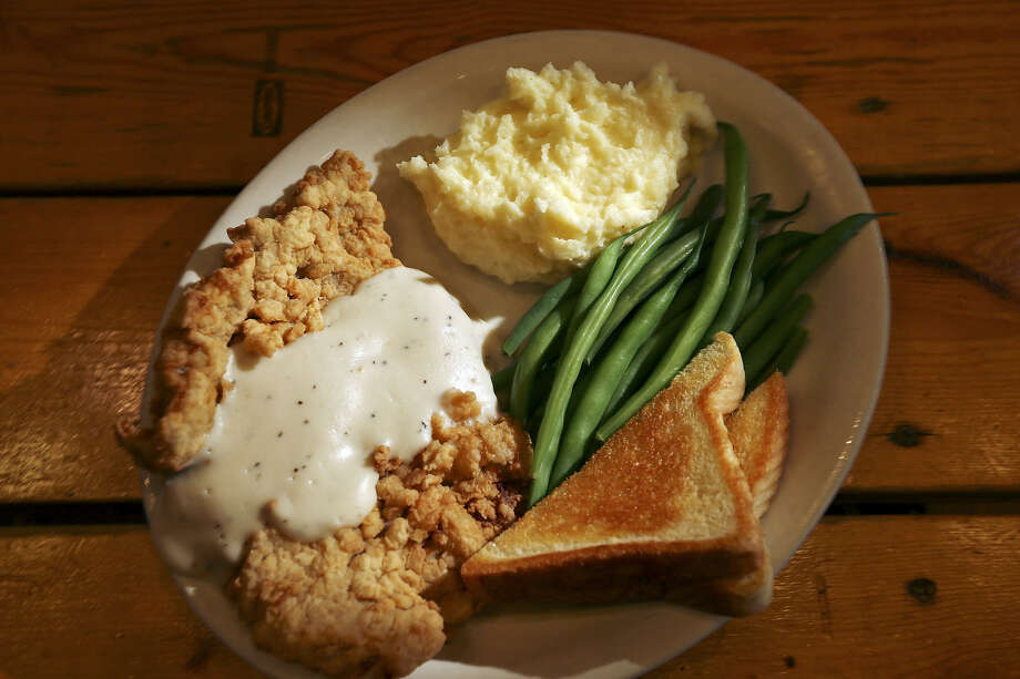 Green beans and mashed potatoes add flavor and color to the crowd-pleasing chicken-fried steak. Photo: Photos By Edward A. Ornelas / San Antonio Express-News