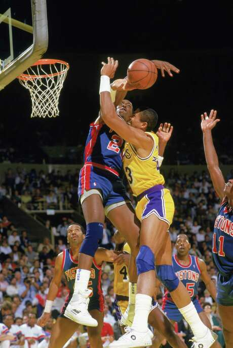 John Salley and the Pistons muscled their way past Mychal Thompson and the Lakers for the 1989 NBA title a year after losing Game 7 of the NBA Finals. Photo: Stephen Dunn / Getty Images