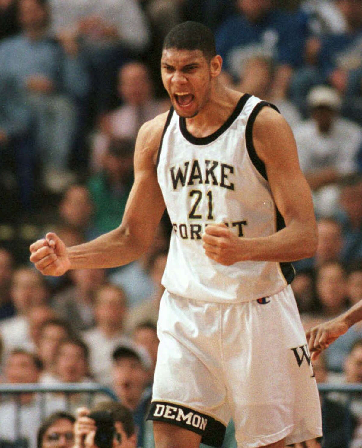 Tim Duncan 1996 Wake Forest's Tim Duncan reacts after making a shot to tie the score in their game against Louisville in the NCAA Midwest Regionals in Minneapolis on Thursday, March 21, 1996. Duncan was fouled on the shot and his subsequent free throw put Wake Forest ahead to win, 60-59.