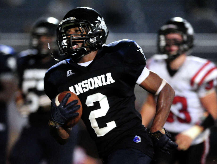 Ansonia's Arkeel Newsome carries the ball to the endzone for a touchdown, during football action against Masuk in Ansonia, Conn. on Thursday October 17 2013. Photo: Christian Abraham / Connecticut Post