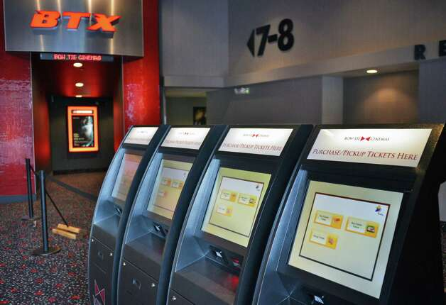 Automated ticket machines inside the new Bow Tie Cinemas at Wilton Mall Thursday Oct. 24, 2013, in Saratoga Springs, N.Y.  (John Carl D'Annibale / Times Union) Photo: John Carl D'Annibale / 00024345A