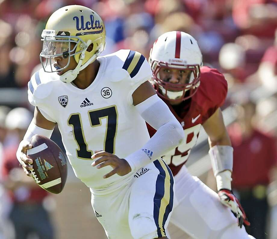 UCLA quarterback Brett Hundley (17) probably concurs that Luke Kaumatule's return to defense is paying off for Stanford. Photo: Marcio Jose Sanchez, Associated Press