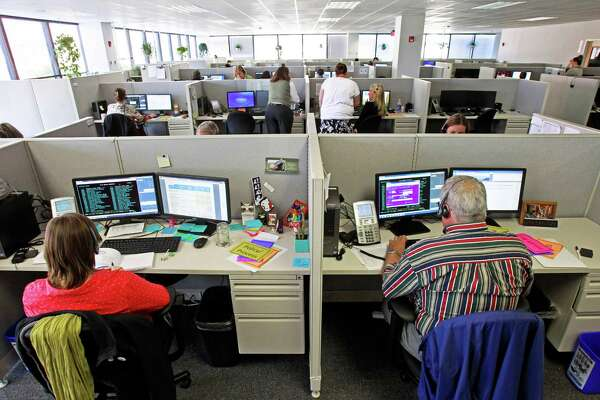 FILE-In this Oct. 1, 2013 file photo, workers at the Vermont Health Connect call center talk to customers in Burlington, Vt. Gov. Peter Shumlin says the Vermont Health Connect health insurance marketplace's performance is improving, and there's no need now to talk about contingency plans in case it isn't fully functional by year's end. Shumlin told a news conference on Thursday that while some people may still be experience slowness or glitches on the system's website, it's working for a growing number of Vermonters. (AP Photo/Toby Talbot, File)