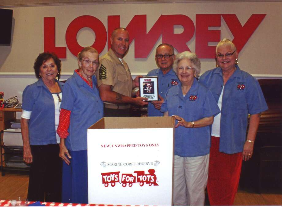 Master Sergeant Mack Grimmett presented a plague to L.I.F.E. Club officers, from left, Carolyn Padilla, Martina Boe, Paul Vernon, Gerry Steed and Linda Callaway. Photo: Courtesy Of Space City L.I.F.E Club