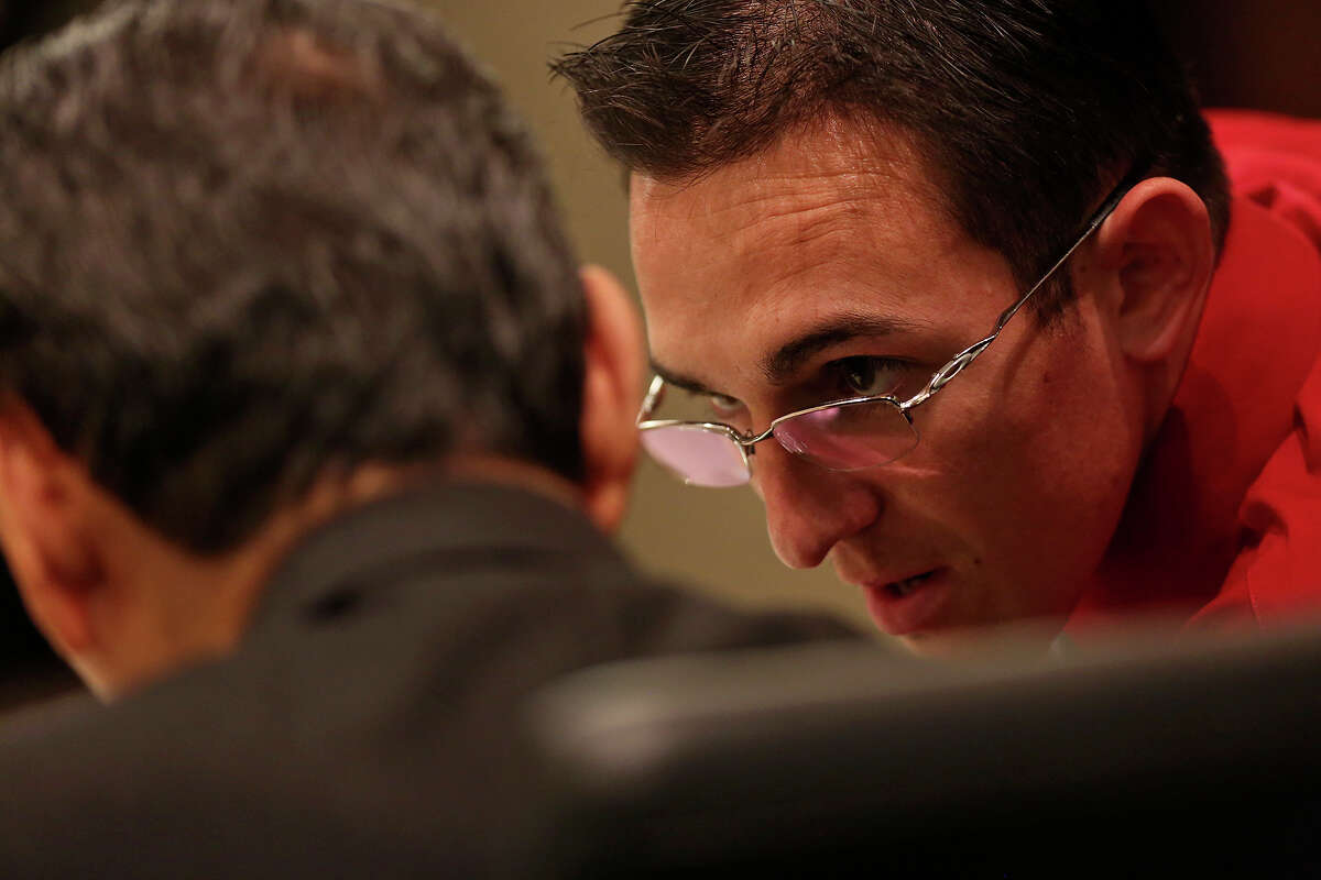 Lee Griego talks with his attorney, Robert A. Valdez, during a break in his ex-fiance's testimony during his punishment-only trial in the 379th District Court on Thursday, Oct. 24, 2013.