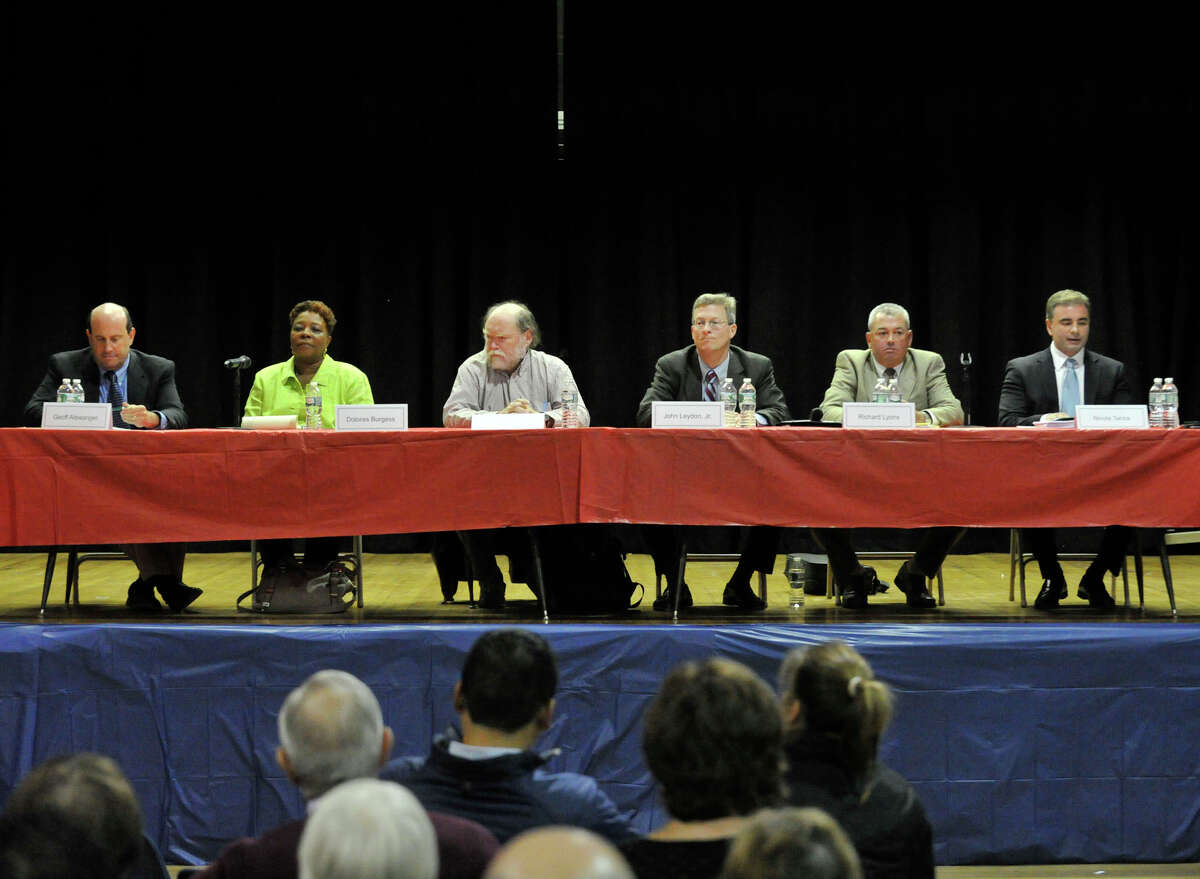 Board of Education candidates on stage from left: Geoff Alswanger, Dolores Burgess, Richard Duffee, John Leydon Jr, Richard Lyons and Nicola Tarzia participate in the Board of Education Candidates Forum hosted by the Parent-Teacher Council of Stamford at the Yerwood Center in Stamford, Conn., on Thursday, Oct. 24, 2013.