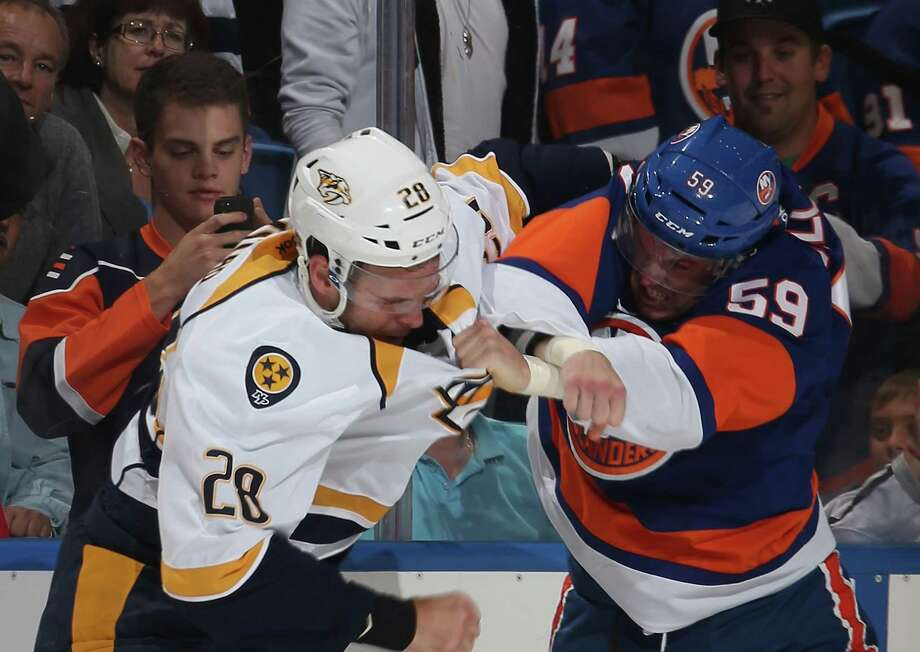 Paul Gaustad #28 of the Nashville Predators and Brett Gallant #59 of the New York Islanders fight during the first period in a preseason game at Nassau Veterans Memorial Coliseum on September 27, 2013 in Uniondale, New York. Photo: Bruce Bennett, Getty Images / 2013 Getty Images