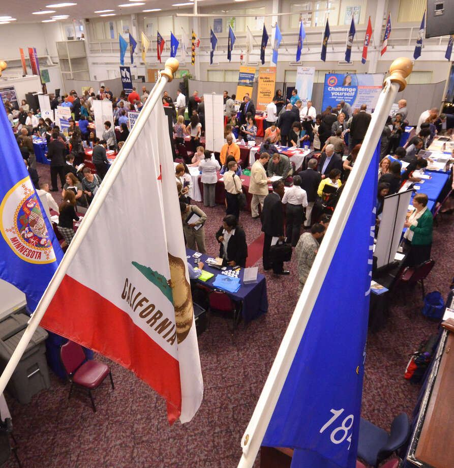 Hundreds of job seekers attend the Hiring Our Heroes job fair Thursday at Fort Sam Houston. The event was among the largest of its kind, according to Kim Morton, a spokeswoman for the U.S. Chamber of Commerce Foundation. Photo: Photos By Robin Jerstad / For The San Antonio Express-News