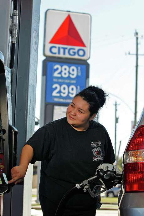 Alma Montelongo takes advantage of lower gasoline prices to fill up her vehicle. Photo: Johnny Hanson, Staff / Houston Chronicle